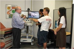 Faculty members at UT Austin demonstrating telemedicine