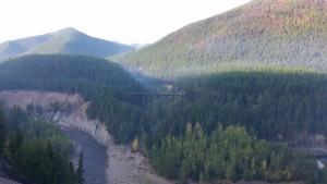 This bridge near Kalispell, MT carries a broadband line that helps connect providers like Kalispell Regional Healthcare to other providers throughout frontier and rural Montana. As we crossed the bridge, forest fires threatened the bridge, highway and area around us. Click for a larger image.
