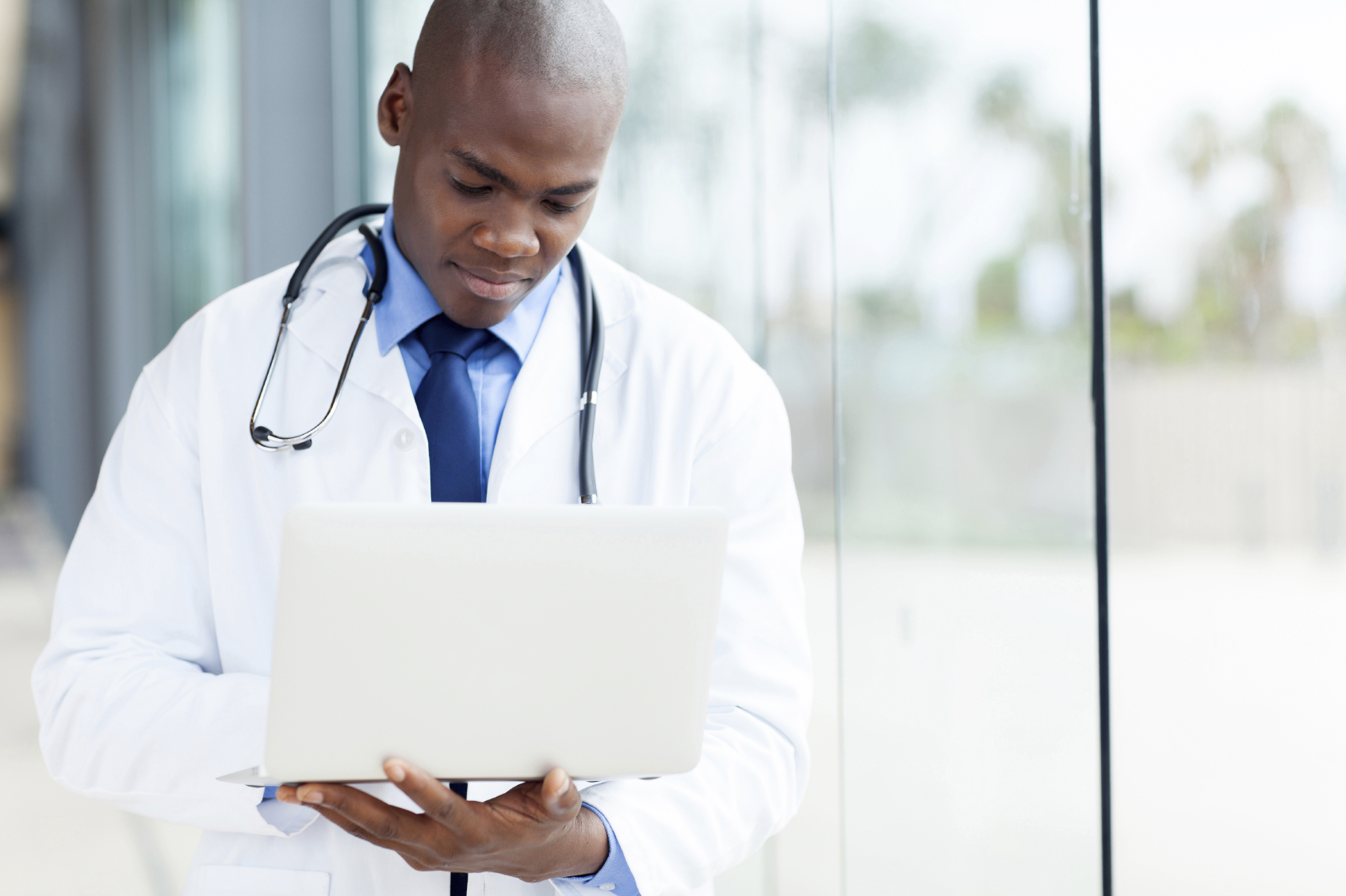 Health care provider using laptop