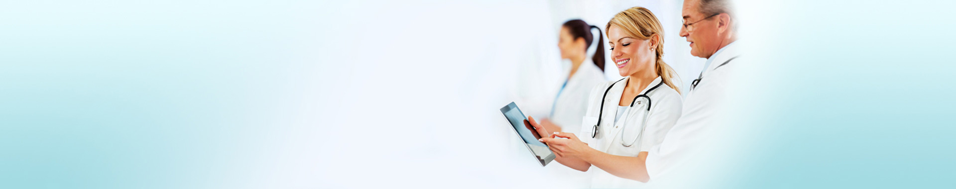 Doctors using a tablet device